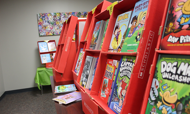 books displayed in classic red scholastic book fair shelves.