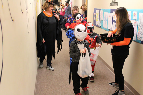 A group of special education students get ready for a Halloween parade