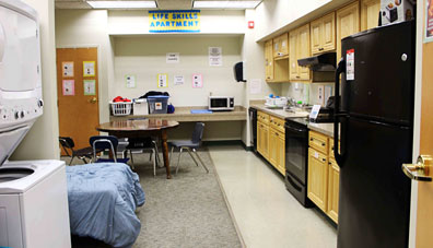 A life skills apartment at a special needs school waits to help students learn independence.