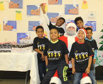 Students in an autism support program smile as they visit with Santa Claus