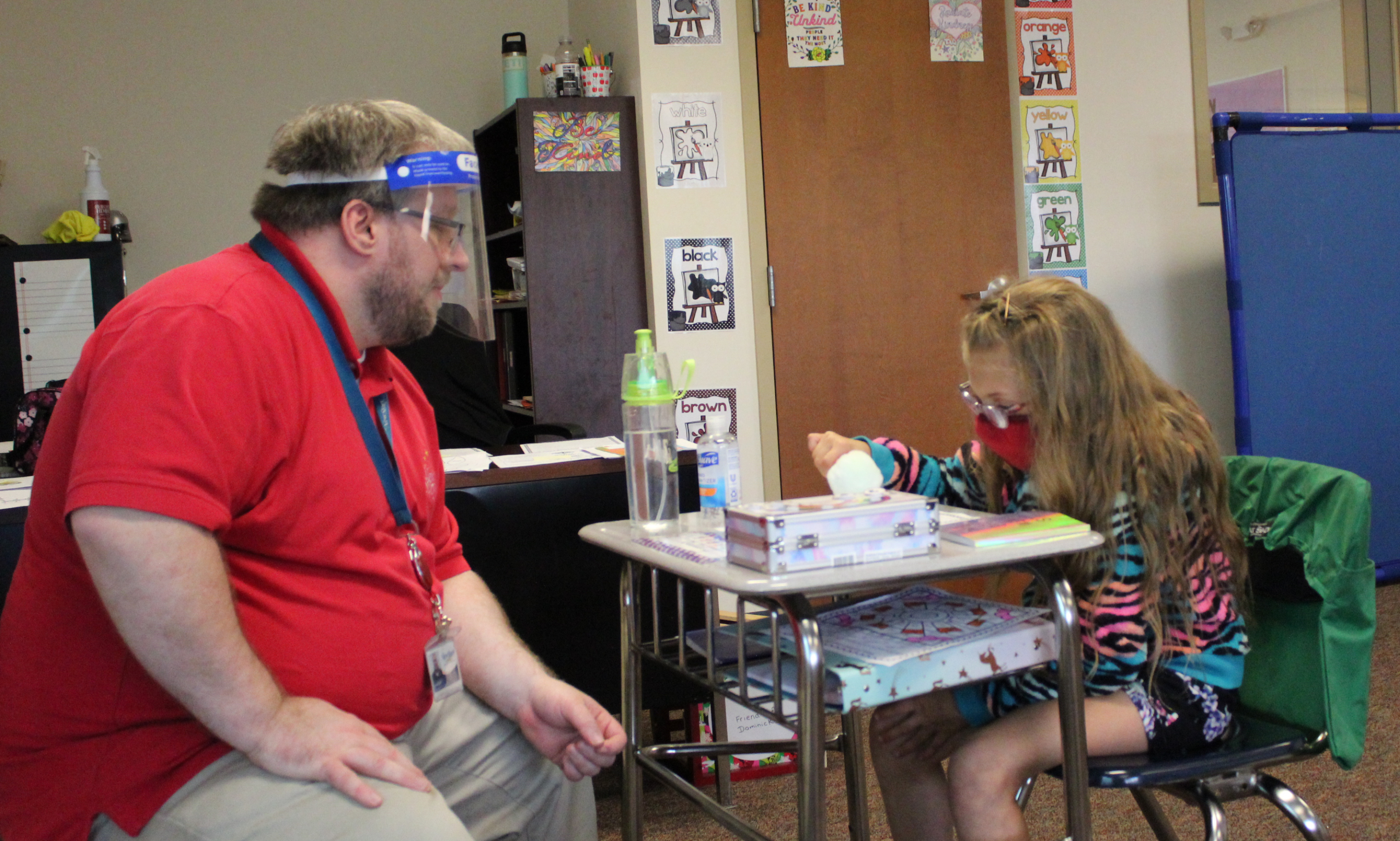Special Education Teacher working with Student in masks