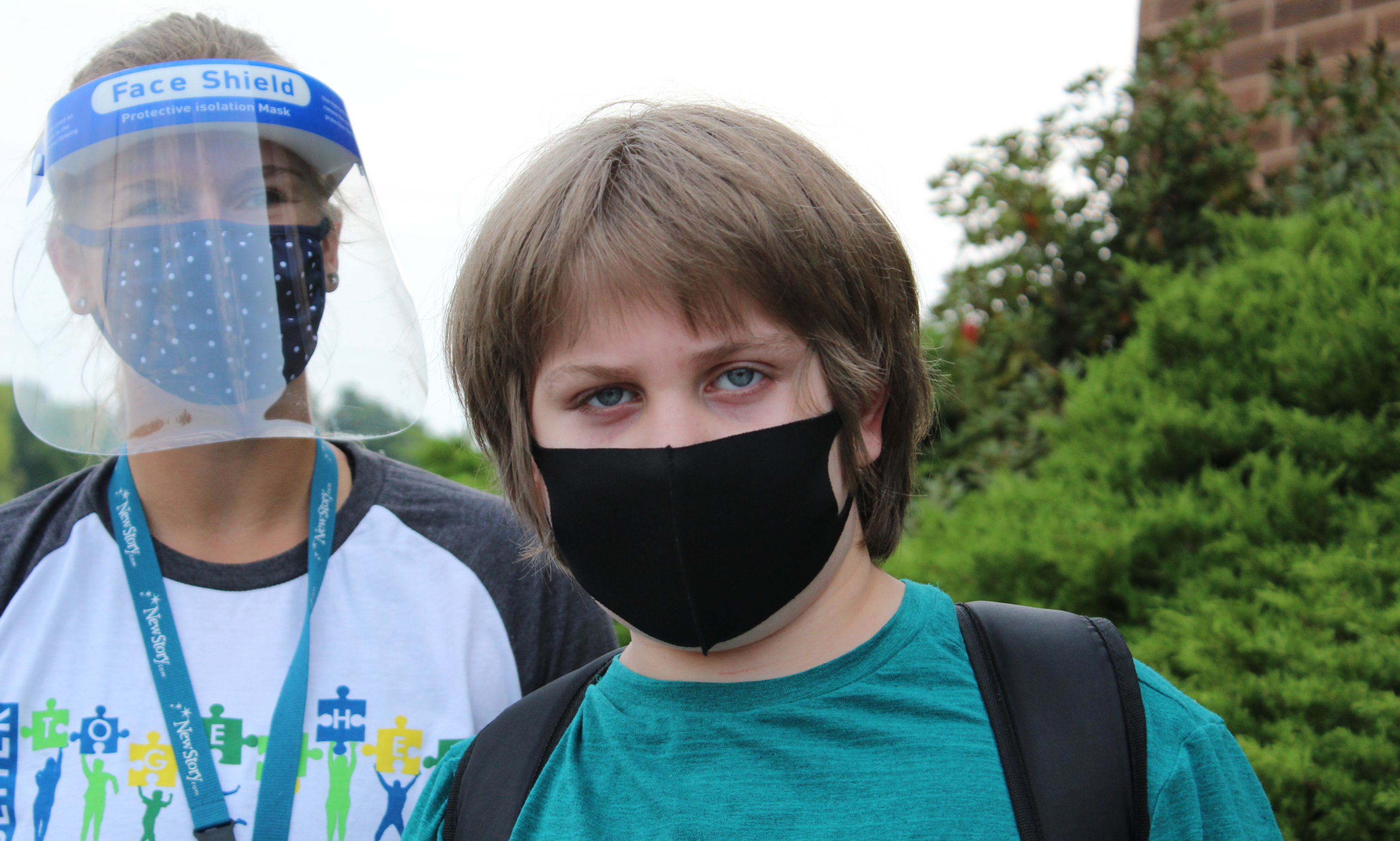 Student and staff with mask