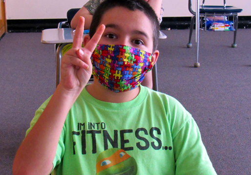 Students adjust to wearing a mask during their school day.
