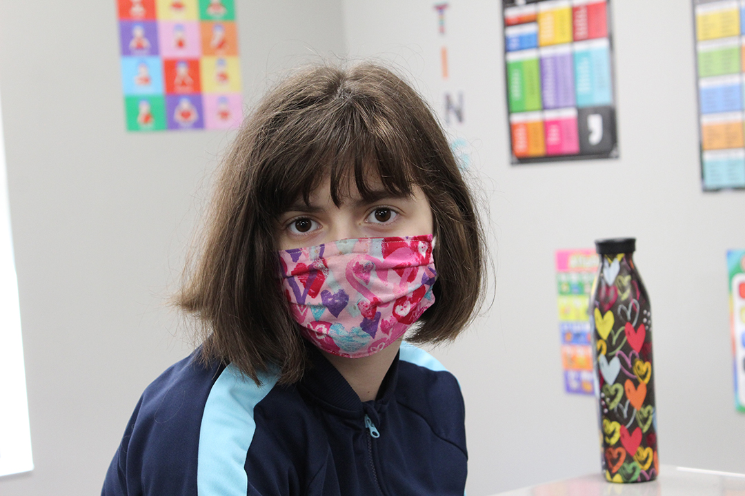 Special Education Student in colorful mask.