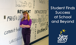 new-story-schools-student-stands-next-to-mural