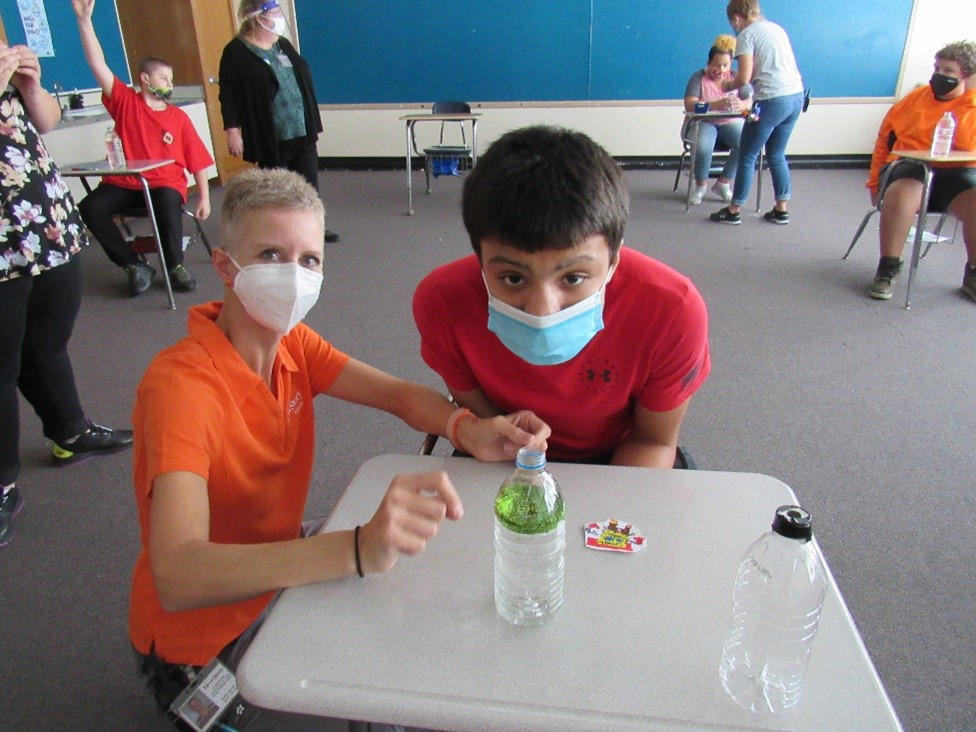 Students learn about tornadoes in class and make their own using soda bottles.